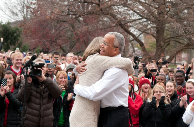 Illinois State President Al Bowman hugs his wife, Linda, during Friday's rally.