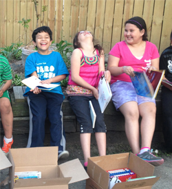 The School of Teaching and Learning organized a book drive that delivered three boxes of books to La Biblioteca. The members had a chance to open the boxes themselves and view some of their favorite books.