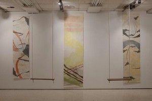 Installation shot of Lisa Lofgren's Swing Series (relief, intaglio, graphite) with copper plate and cherry wood swings.