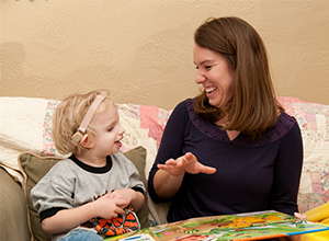Molly Herman reading with one of her deaf and hard of hearing preschool students.
