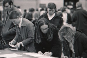 Students register for classes at a table