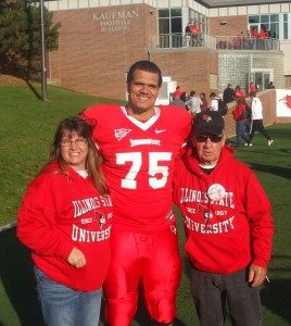 Charlie with his parents on the field