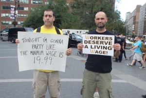 Two men at a New York City living wage rally