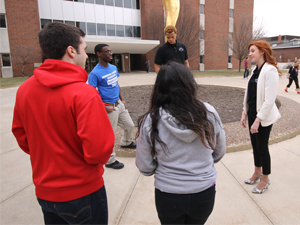 Colleen 'Burger talks with her high school students from Richards Career Academy in Chicago outside Stevenson Hall.