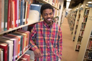 Dyrell Ashley poses in library