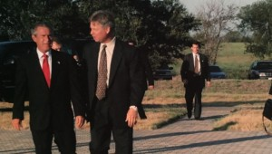Mark Lowery in the background protecting President George W. Bush