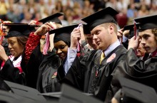 Students flip their tassels