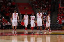 Redbird basketball players walk on court