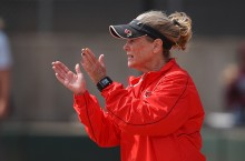 Redbird softball coach Melinda Fischer cheers