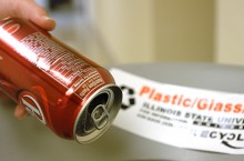 A student recycles a can