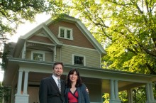 Jessica '93 and Jason Chambers in front of their home, the former residence of Charles DeGarmo