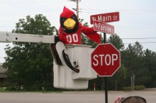 Reggie Redbird with new street signs