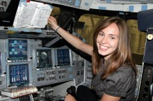Andrea Bruck in a space shuttle mockup