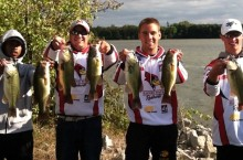 bass fishing team holds their catch