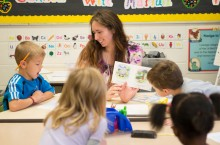 An Illinois State teacher candidate engages students in a literacy lesson.