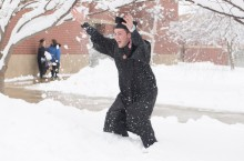 Graduate celebrates in the snow
