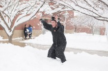 new graduate celebrates in snow