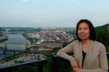 Yuwadee Viriyangkura overlooking downtown Pittsburgh at the 2013 American Association on Intellectual and Developmental Disabilities (AAIDD).