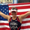 Melissa Stockwell holds a flag