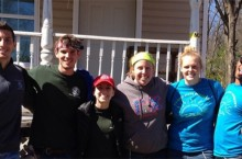 Students outside Habitat house