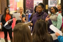 Teneisha Huley instructs Illinois State students who provided tours and helped TEACH Club members from Chicago Public Schools experience