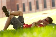 student relaxing on the Quad