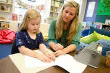 A teacher candidate in the Department of Special Education works with a Thomas Metcalf School student in the low vision and blindness program.