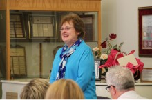 Diane Mather speaks at a meeting