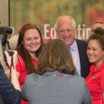 Pat Quinn takes a photo with students