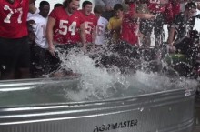 Football players dive into ice bucket