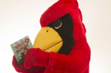 Reggie Redbird reads his new children's book