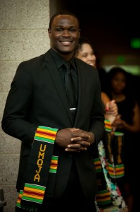 Ita Adebayo poses with his Kente cloth