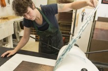 Lisa Lofgren doing printmaking