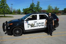 Alum in front of patrol vehicle