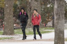 students walk through the snow