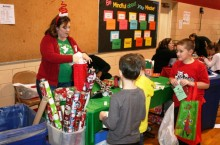 Metcalf School students have their gifts wrapped after shopping at the Holiday Bazaar.