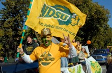North Dakota State University fan with flag