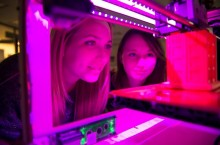 Redbird educators check out a 3-D printer at T21Con.