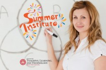 Woman at a board that says Summer Institute