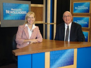 Joe Taylor sitting with a news anchor on the news