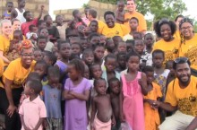 students pose with kids in Ghana