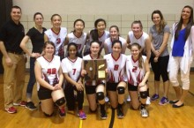 Volleyball team poses for a team picture.