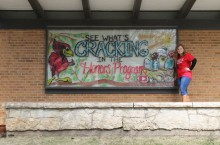 Honors student leader Sarah Foote in front of the Honors window