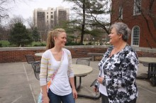 Maureen Smith (left) talks with a nontraditional prospective student about an academic career at the Illinois State College of Education.