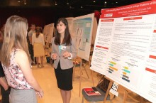 Female student presenting at research symposium
