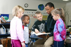 A Chicago Teacher Education Pipeline student works with elementary education students on a literacy lesson.