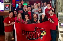 group of people with Illinois State flag