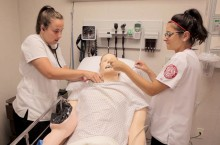 students work with a patient simulator