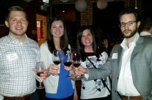 four people cheering with wine