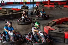 six people driving on go-kart track